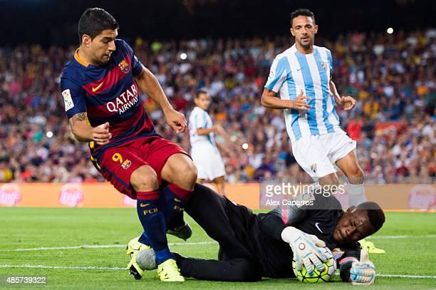 Goalkeeper Carlos Kameni of Malaga CF blocks the ball next to Luis Suarez of FC Barcelona during the La Liga match between FC Barcelona and Malaga CF...