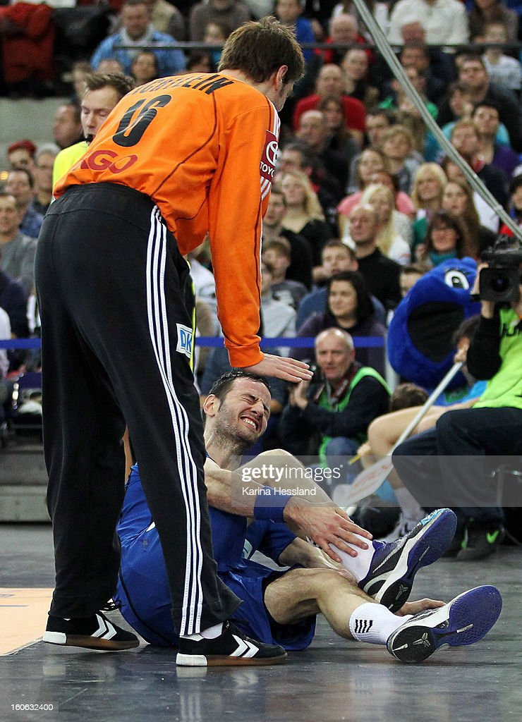 Goalkeeper Carsten Lichtlein of Germany at Iker Romero of Bundesliga All Stars, he lies on the floor with pain during the match between Germany and Bundesliga All Stars on February 2, 2013 in Leipzig, Germany.