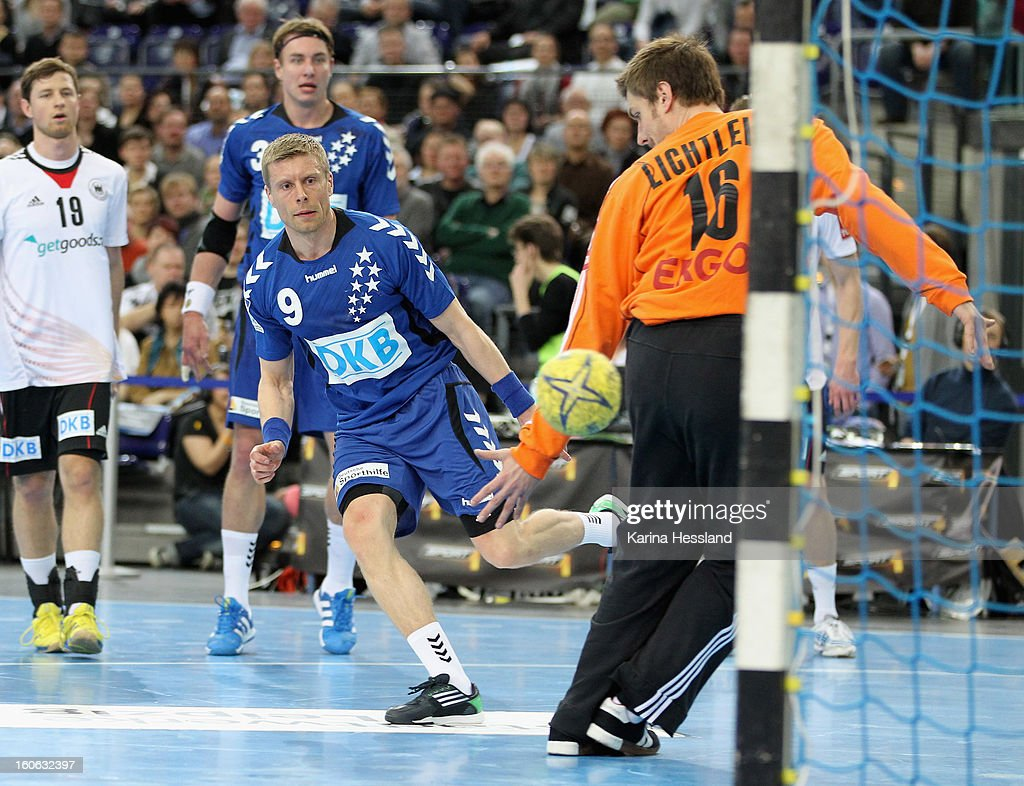 Goalkeeper <a gi-track='captionPersonalityLinkClicked' href=/galleries/search?phrase=Carsten+Lichtlein&family=editorial&specificpeople=577209 ng-click='$event.stopPropagation()'>Carsten Lichtlein</a> of Germany reacts, <a gi-track='captionPersonalityLinkClicked' href=/galleries/search?phrase=Gudjon+Valur+Sigurdsson&family=editorial&specificpeople=2506024 ng-click='$event.stopPropagation()'>Gudjon Valur Sigurdsson</a> of Bundesliga All Stars throws the ball during the match between Germany and Bundesliga All Stars on February 2, 2013 in Leipzig, Germany.