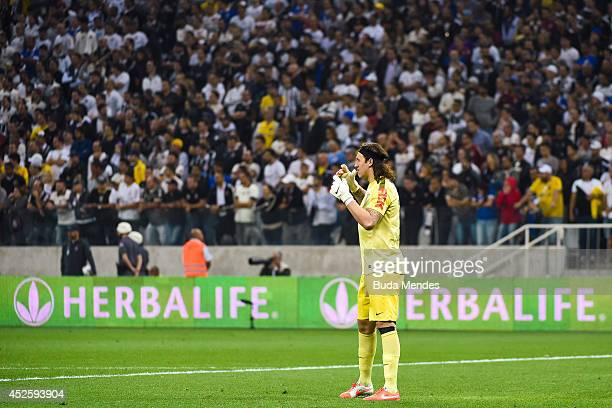 Goalkeeper Cassio of Corinthians celebrates a scored goal of Renato Augusto against Bahia during a match between Corinthians and Bahia as part of...