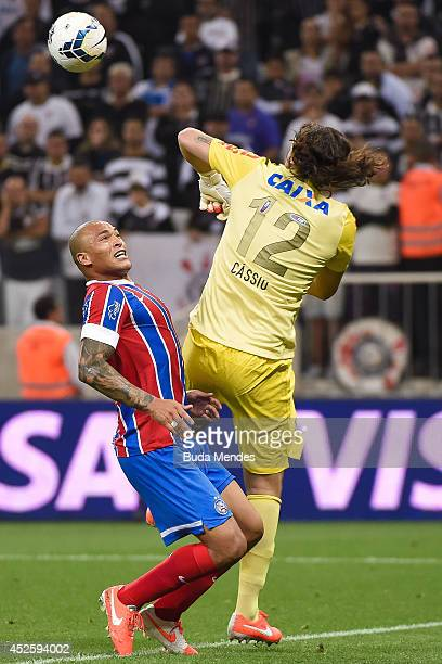 Goalkeeper Cassio of Corinthians struggles for the ball with a Titi of Bahia during a match between Corinthians and Bahia as part of Copa do Brasil...