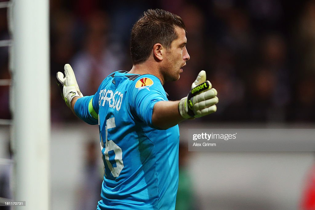 Goalkeeper <a gi-track='captionPersonalityLinkClicked' href=/galleries/search?phrase=Cedric+Carrasso&family=editorial&specificpeople=661919 ng-click='$event.stopPropagation()'>Cedric Carrasso</a> of Bordeaux reacts during the UEFA Europa League Group F match between Eintracht Frankfurt and FC Girondins de Bordeaux at Commerzbank Arena on September 19, 2013 in Frankfurt am Main, Germany.