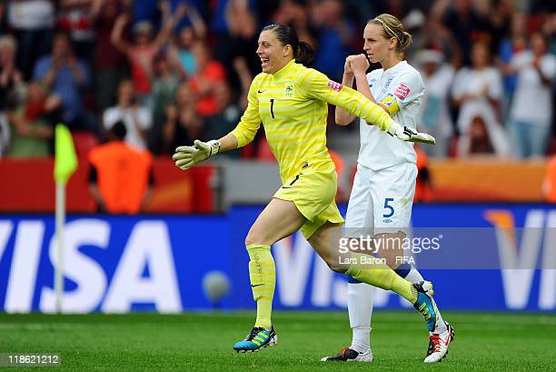 Goalkeeper Celine Deville of France celebrates next to Faye White who missed the last penalty after winning the FIFA Women's World Cup 2011 Quarter...