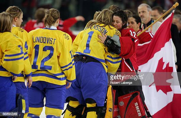 Goalkeeper Charline Labonte of Canada embraces Goalkeeper Cecilia Andersson of Sweden after the final of the women's ice hockey between Sweden and...