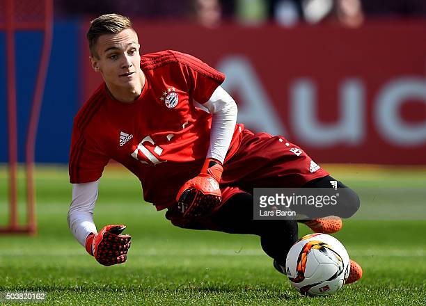 Goalkeeper Christian Fruech dives for the ball during a training session at day two of the Bayern Muenchen training camp at Aspire Academy on January...