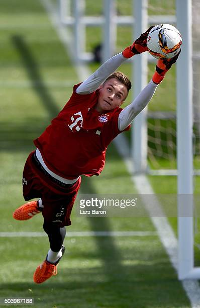 Goalkeeper Christian Fruechtl jumps for the ball during a training session at day three of the Bayern Muenchen training camp at Aspire Academy on...