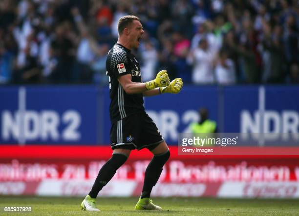 Goalkeeper Christian Mathenia of HSV celebrates the first goal scoring of Filip Kostic of HSV during the Bundesliga match between Hamburger SV and...