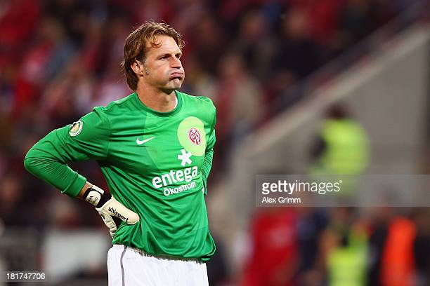 Goalkeeper Christian Wetklo of Mainz reacts after the DFB Cup second round match between 1 FSV Mainz 05 and 1 FC Koeln at Coface Arena on September...