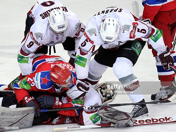 Goalkeeper Christopher Holt Krisjanis Redlihs and Janis Sprukts of the Riga keep Niklas Persson of the CSKA away from the puck during the KHL...