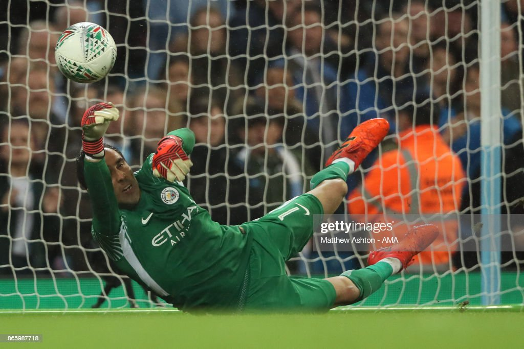 Goalkeeper Claudio Bravo Manchester City saves a penalty from Alfred NDiaye of Wolverhampton Wanderers during the penalty shoot out in the Carabao Cup Fourth Round fixture between Manchester City and Wolverhampton Wanderers at Etihad Stadium on October 24, 2017 in Manchester, England.