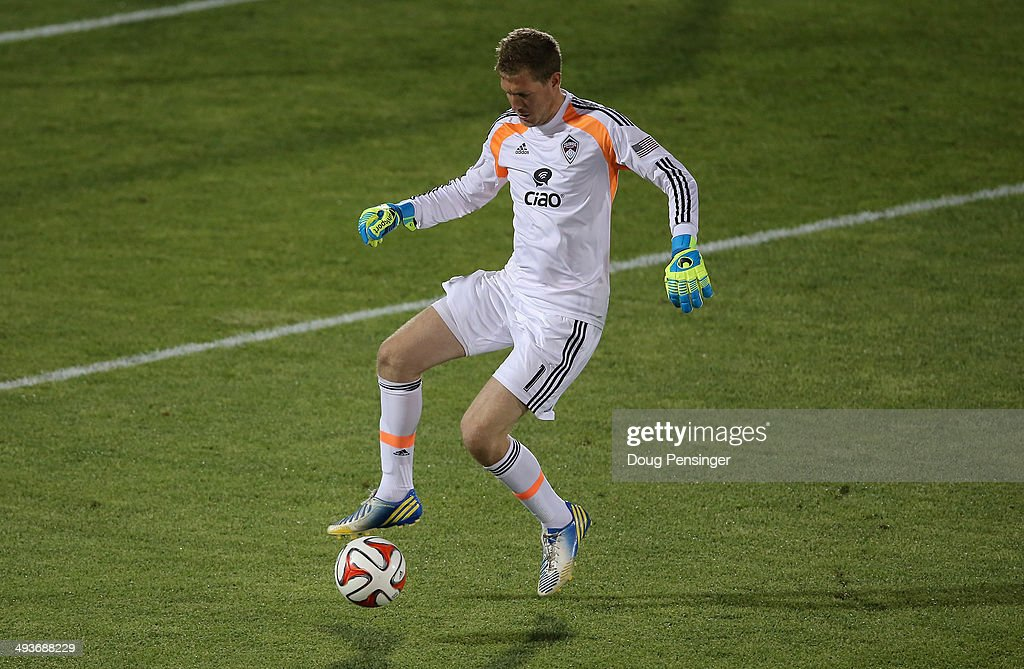 Goalkeeper Clint Irwin #1 of the Colorado Rapids controls the ball against the Montreal Impact at Dick's Sporting Goods Park on May 24, 2014 in Commerce City, Colorado. The Rapids defeated the Impact 4-1.