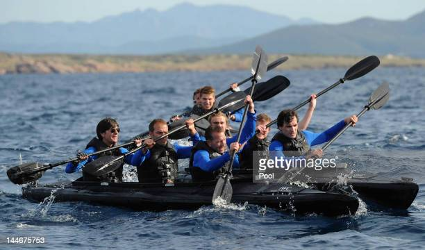Goalkeeper coach Andreas Koepke assistant coach HansDieter Flick and Head coach Joachim Loew comepete during a boat race of the German national...