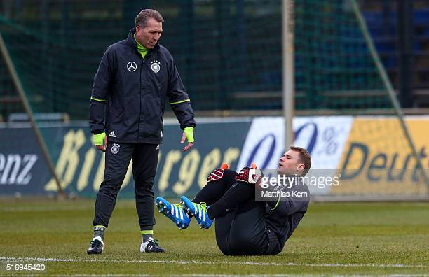 Goalkeeper coach Andreas Koepke of Germany and goalkeeper Manuel Neuer look on during a Germany training session ahead of their International frindly...