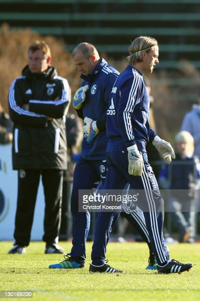 Goalkeeper coach Bernd Dreher Mathias Schober and Timo Hildebrand attend the FC Schalke training session at the training ground at Veltins Arena on...