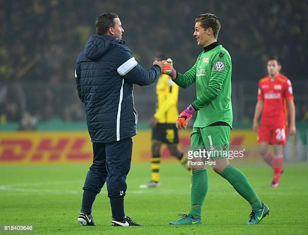 goalkeeper coach Dennis Rudel and Daniel Mesenhoeler of 1FC Union Berlin during the game between Borussia Dortmund and dem 1 FC Union Berlin on...