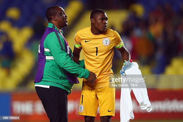 Goalkeeper coach Emeka Amadi and goalkeeper Akpan Udoh of Nigeria celebrate after the FIFA U17 World Cup Chile 2015 Semi Final match between Mexico...