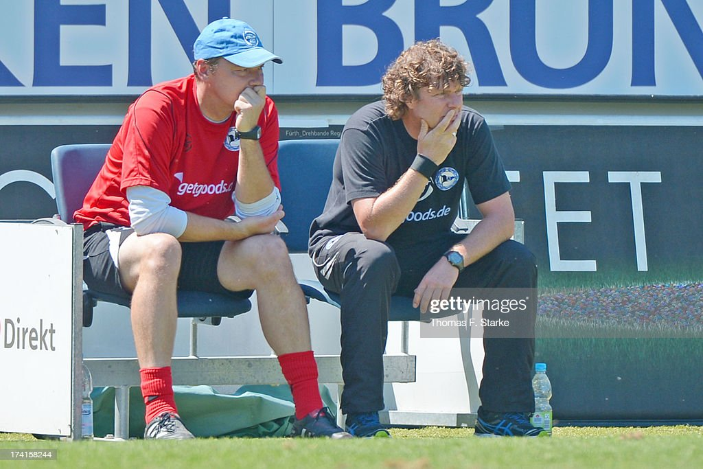 Goalkeeper coach Marco Kostmann (L) and head coach Stefan Kraemer of Bielefeld look dejected during the Second Bundesliga match between Greuther Fuerth and Arminia Bielefeld at the Trolli Arena on July 21, 2013 in Fuerth, Germany.