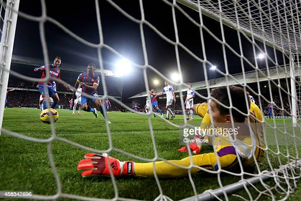 Goalkeeper Costel Pantilimon of Sunderland saves the header from Marouane Chamakh of Crystal Palace immediately prior to to teammate Wes Brown of...