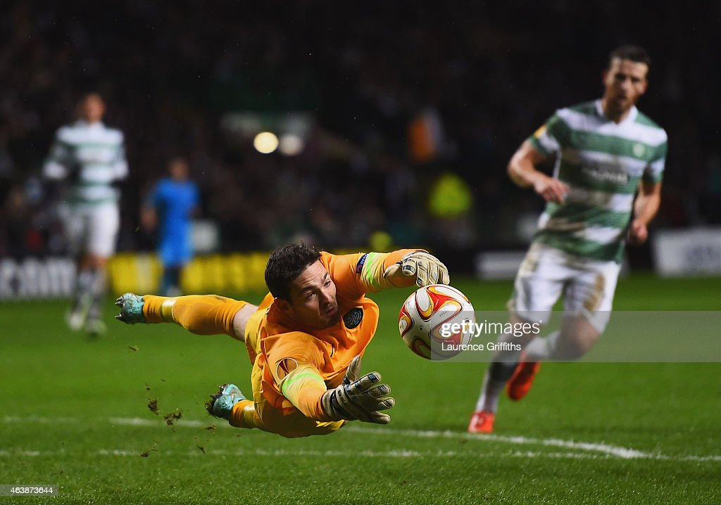 Goalkeeper Craig Gordon of Celtic fails to hold the ball allowing Rodrigo Palacio of Inter Milan (8) to score their third goal during the UEFA Europa League Round of 32 first leg match between Celtic FC and FC Internazionale Milano at Celtic Park Stadium on February 19, 2015 in Glasgow, United Kingdom.