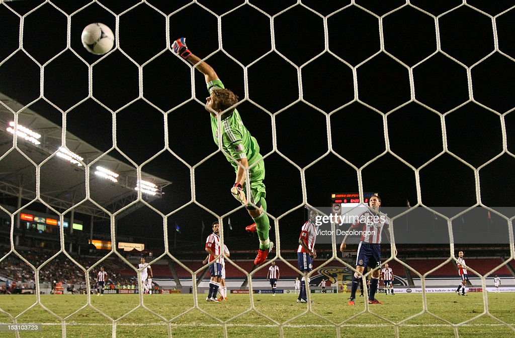 Goalkeeper Dan Kennedy of Chivas USA can't make the save on a shot for a goal by Alvaro Saborio of Real Salt Lake as teammates Danny Califf and John...
