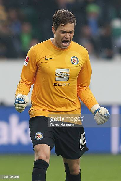 Goalkeeper Daniel Davari of Braunschweig celebrates his team's second goal during the Bundesliga match between VfL Wolfsburg and Eintracht...