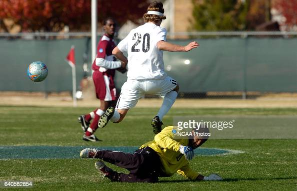 Goalkeeper Daniel Hansen of Franklin Pierce takes the ball from John Cunliffe during the Men's Division II Soccer Championship held on the Campus of...