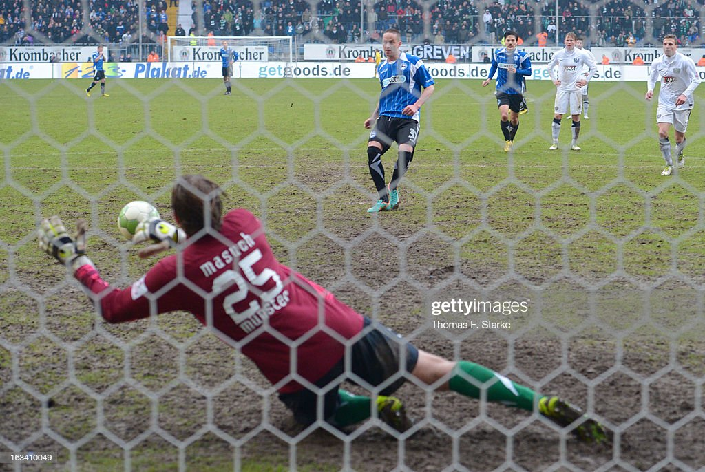 Goalkeeper Daniel Masuch of Muenster saves a penalty from Christian Mueller of Bielefeld during the Third League match between Arminia Bielefeld and Preussen Muenster at Schueco Arena on March 9, 2013 in Bielefeld, Germany.