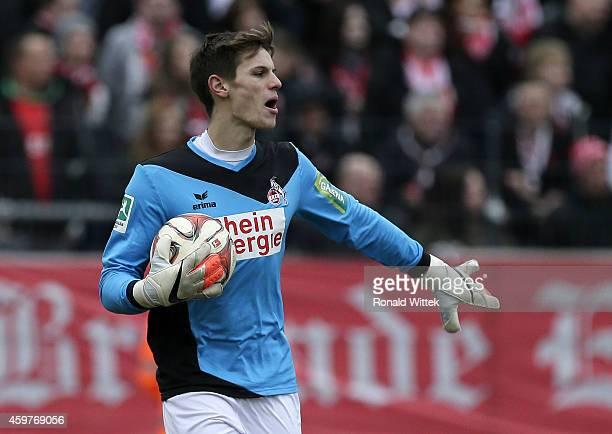 Goalkeeper Daniel Mesenhoeler of Koeln runs with the ball during the Regionalliga West match between 1 FC Koeln II and RotWeiss Essen at...