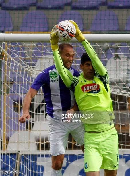 Goalkeeper Danijel Petkovic of MTK Budapest catches the ball before Janos Lazok of Ujpest FC during the Hungarian OTP Bank Liga match between Ujpest...