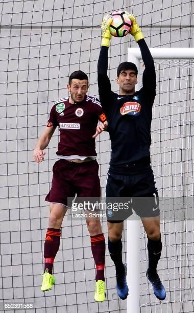 Goalkeeper Danijel Petkovic of MTK Budapest catches the ball next to Kire Ristevski of Vasas FC during the Hungarian OTP Bank Liga match between MTK...