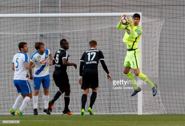 Goalkeeper Danijel Petkovic of MTK Budapest catches the ball next to Mato Grgic of MTK Budapest Adam Vass of MTK Budapest Ulysse Diallo of Mezokovesd...