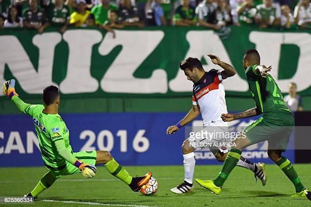 Goalkeeper Danilo of Brazil's Chapecoense vies for the ball with Martín Cauteruccio of Argentina's San Lorenzo during their 2016 Copa Sudamericana...