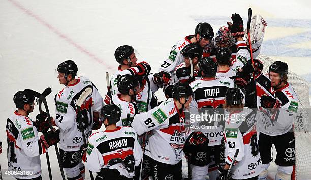 Goalkeeper Danny aus den Birken of Koeln celebrates with team mates after the DEL match between Adler Mannheim and Koelner Haie at SAP Arena on...