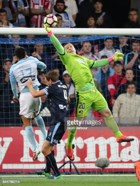 Goalkeeper Danny Vukovic of Sydney FC makes a save as Tim Cahill of City competes for the ball during the round 21 ALeague match between Melbourne...