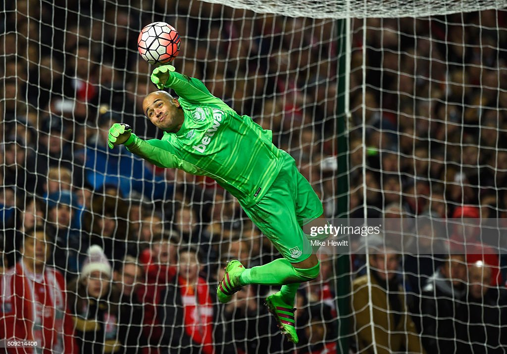 Goalkeeper <a gi-track='captionPersonalityLinkClicked' href=/galleries/search?phrase=Darren+Randolph&family=editorial&specificpeople=3947785 ng-click='$event.stopPropagation()'>Darren Randolph</a> of West Ham United makes a save during the Emirates FA Cup Fourth Round Replay match between West Ham United and Liverpool at Boleyn Ground on February 9, 2016 in London, England.