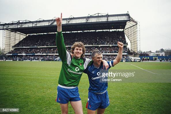 Goalkeeper David Beasant and captain Graham Roberts celebrate promotion to Division One after a League Two match against Leeds United at Stamford...