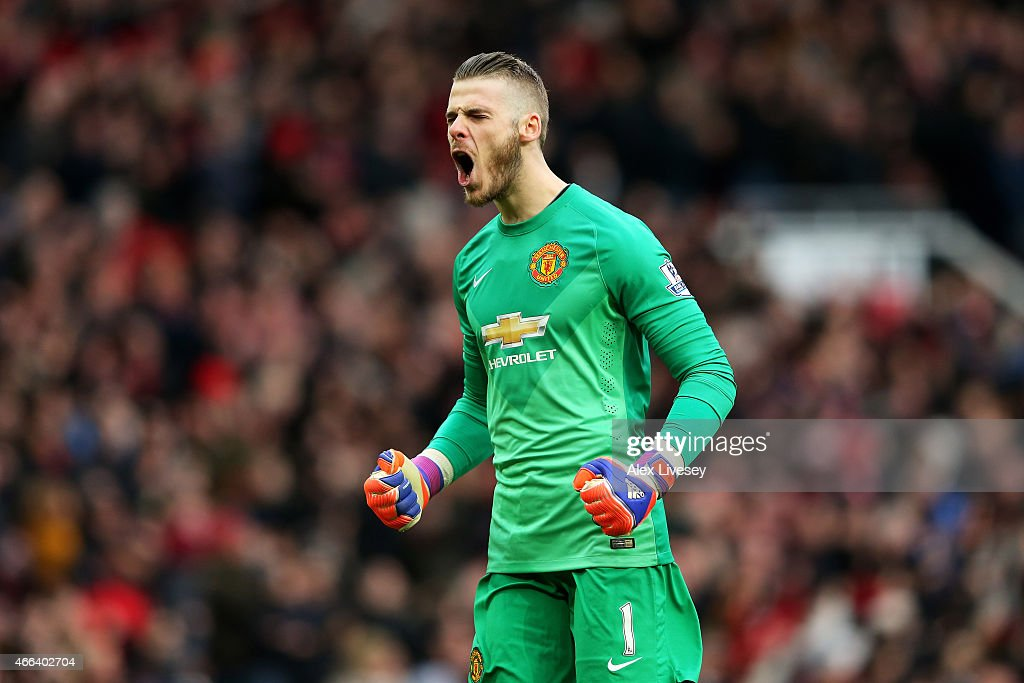 Goalkeeper David De Gea of Manchester United celebrates after teammate Marouane Fellaini scores the opening goal during the Barclays Premier League match between Manchester United and Tottenham Hotspur at Old Trafford on March 15, 2015 in Manchester, England.