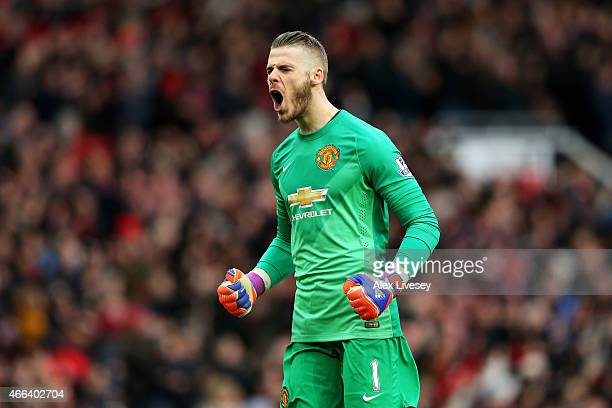 Goalkeeper David De Gea of Manchester United celebrates after teammate Marouane Fellaini scores the opening goal during the Barclays Premier League...