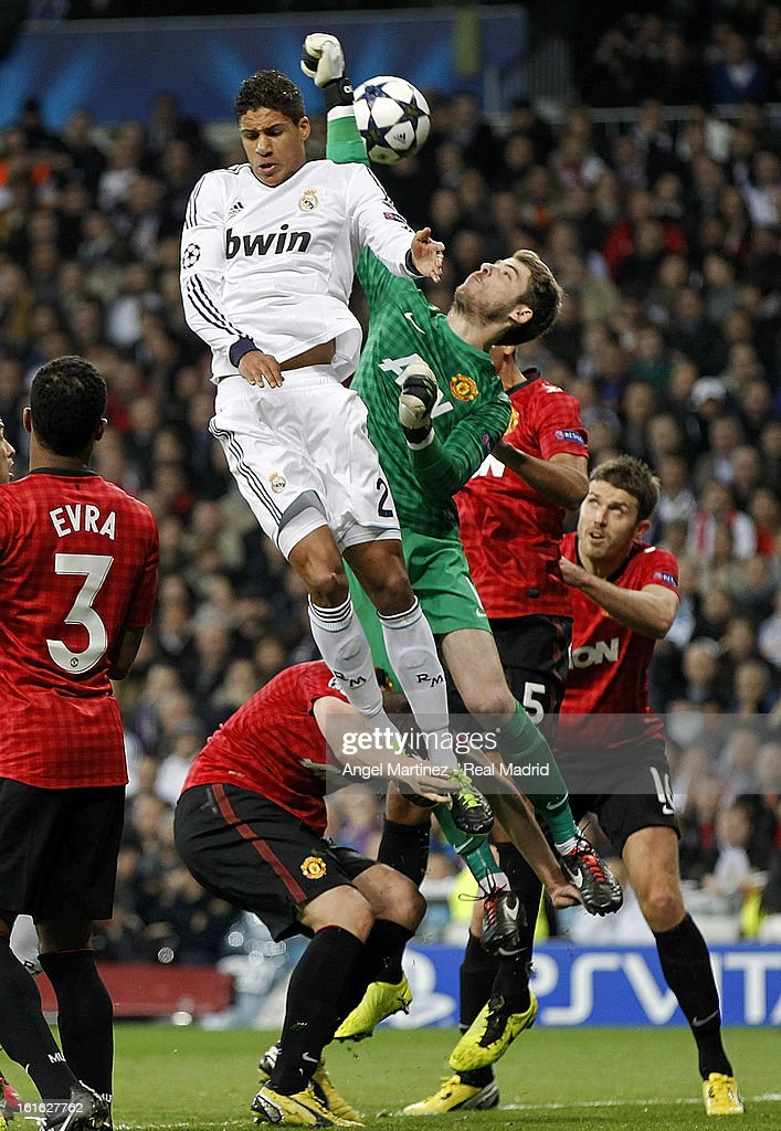 Goalkeeper David de Gea of Manchester United competes for a high ball with Raphael Varane of Real Madrid during the UEFA Champions League Round of 16 first leg match between Real Madrid and Manchester United at Estadio Santiago Bernabeu on February 13, 2013 in Madrid, Spain.