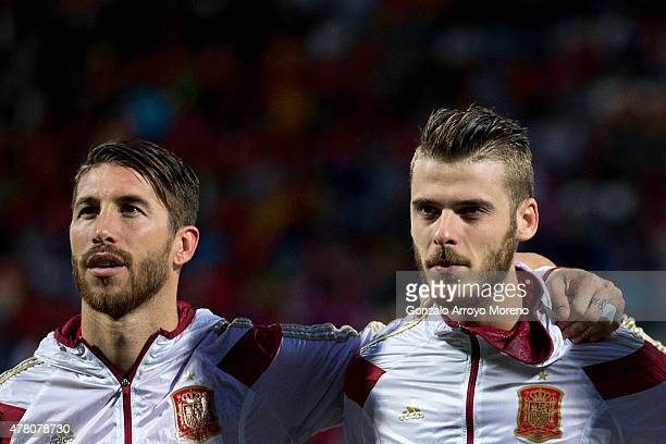 Goalkeeper David de Gea of Spain listen to the Spanish national anthem embraced to his teammate Sergio Ramos during the international friendly match...
