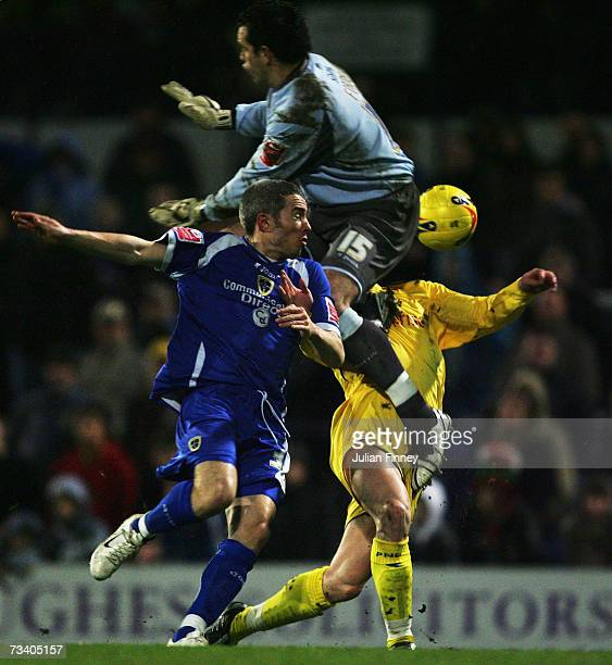 Goalkeeper David Forde and Kevin McNaughton of Cardiff challenge David Nugent of Preston during the CocaCola Championship match between Cardiff City...