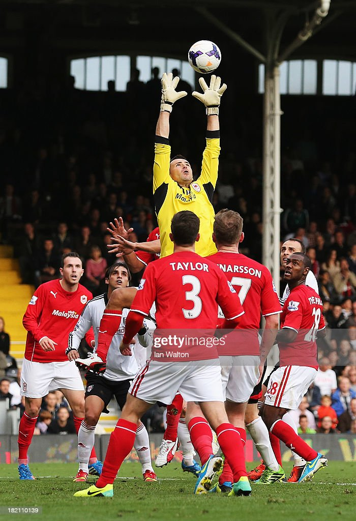 Goalkeeper <a gi-track='captionPersonalityLinkClicked' href=/galleries/search?phrase=David+Marshall&family=editorial&specificpeople=4668874 ng-click='$event.stopPropagation()'>David Marshall</a> of Cardiff City claims a cross during the Barclays Premier League match between Fulham and Cardiff City at Craven Cottage on September 28, 2013 in London, England.