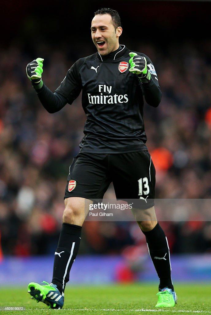 Goalkeeper <a gi-track='captionPersonalityLinkClicked' href=/galleries/search?phrase=David+Ospina&family=editorial&specificpeople=4104267 ng-click='$event.stopPropagation()'>David Ospina</a> of Arsenal celebrates as teammate Olivier Giroud of Arsenal scores the opening goal during the Barclays Premier League match between Arsenal and Aston Villa at the Emirates Stadium on February 1, 2015 in London, England.