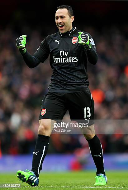 Goalkeeper David Ospina of Arsenal celebrates as teammate Olivier Giroud of Arsenal scores the opening goal during the Barclays Premier League match...