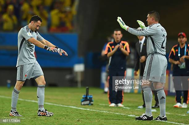 Goalkeeper David Ospina of bows to Faryd Mondragon of Colombia during the 2014 FIFA World Cup Brazil Group C match between Japan and Colombia at...