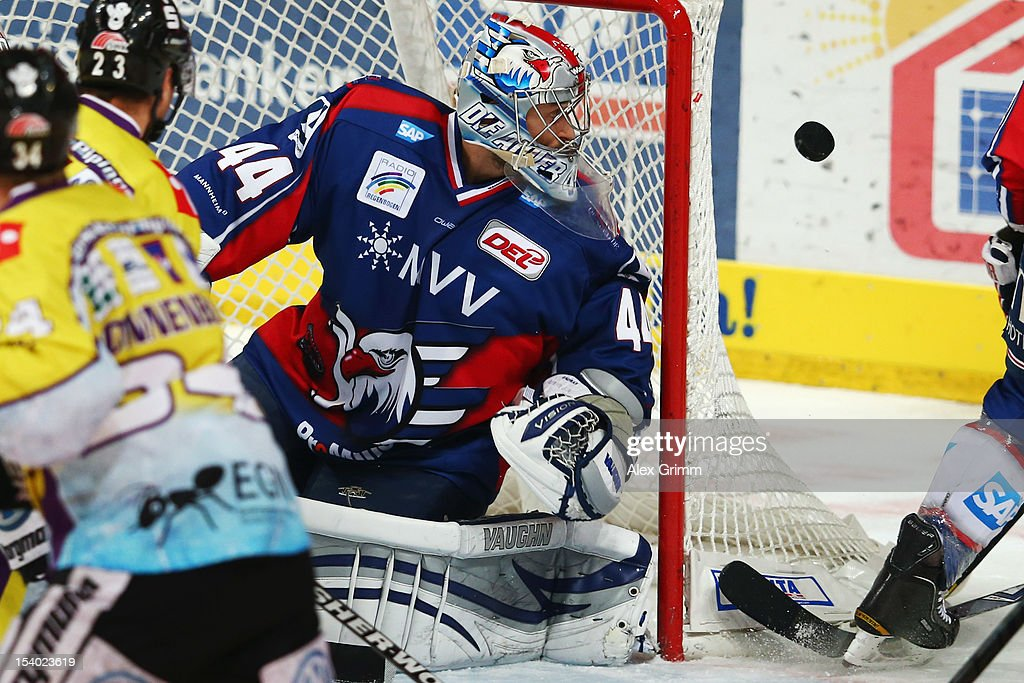 Goalkeeper <a gi-track='captionPersonalityLinkClicked' href=/galleries/search?phrase=Dennis+Endras&family=editorial&specificpeople=5526366 ng-click='$event.stopPropagation()'>Dennis Endras</a> of Mannheim views the puck during the DEL match between Adler Mannheim and Krefeld Pinguine at SAP-Arena on October 12, 2012 in Mannheim, Germany.