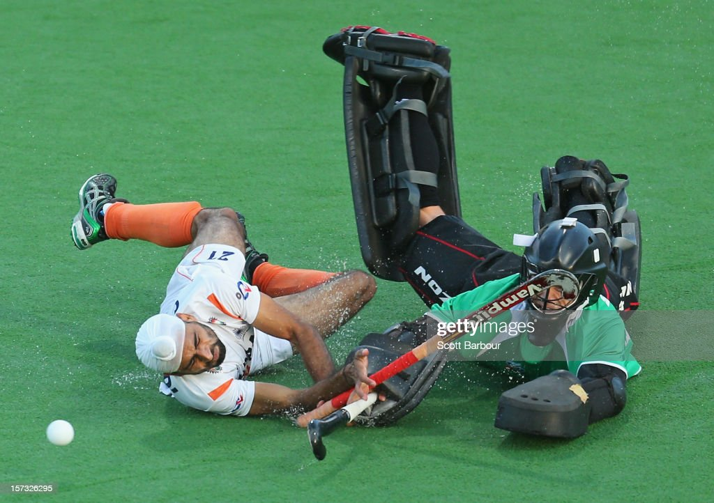 Goalkeeper Devon Manchester of New Zealand and Gurvinder Singh Chandi of India collide as they contest for the ball during the match between New Zealand and India during day two of the Champions Trophy on December 2, 2012 in Melbourne, Australia.