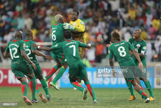 Goalkeeper Diakite Daouda of Burkina Faso celebrates victory with teammates after saving a penalty in a shootout during the 2013 Africa Cup of...