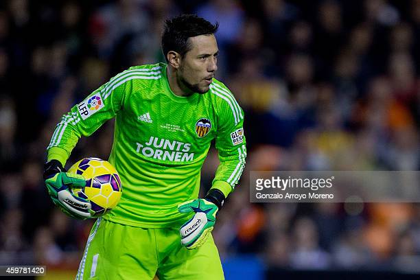 Goalkeeper Diego Alves of Valencia CF hold sthe ball during the La Liga match between Valencia CF and FC Barcelona at Estadi de Mestalla on November...