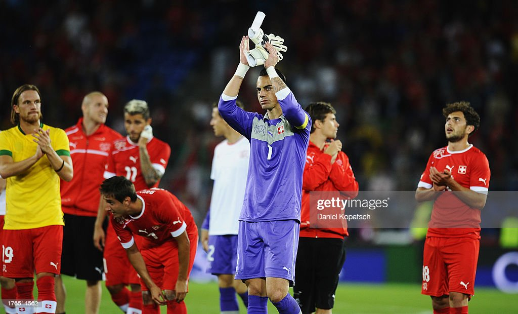 Goalkeeper <a gi-track='captionPersonalityLinkClicked' href=/galleries/search?phrase=Diego+Benaglio&family=editorial&specificpeople=543817 ng-click='$event.stopPropagation()'>Diego Benaglio</a> of Switzerland apllauds the fans after the international friendly match between Switzerland and Brazil at St. Jakob Stadium on August 14, 2013 in Basel, Switzerland.